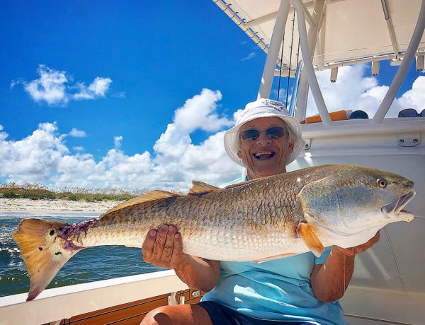 Picture of Man Holding Redfish